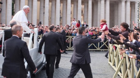 Catire Walker held up his youngest, Carmin, for Pope Francis when the family visited the Vatican in 2013.