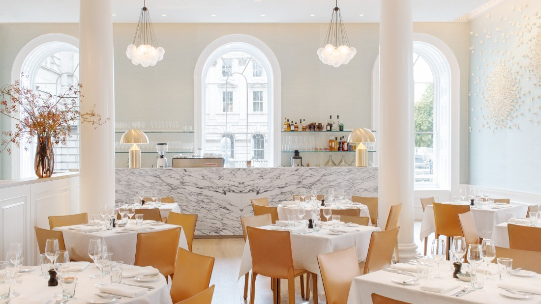 "Located in London's Somerset House, <a href=""http://springrestaurant.co.uk/"" target=""_blank"">Spring's</a> light-flooded drawing room is thanks to large arched windows, airy high ceilings. Original cornicing frames the space achieved by architect <a href=""http://www.stuartforbes.com/"" target=""_blank"">Stuart Forbes</a>. <br /><br />An atrium garden sits enclosed at the room's center with flora and fauna designs by landscape designer Jinny Blom. Other collaborators on the project include artwork by Emma Peascod and Valeria Nascimento and interior design by Australian Briony Fitzgerald."