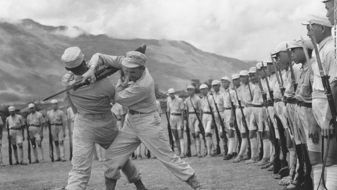 "The United States and China were allies during World War II and more than 250,000 Americans served in what was known as the ""China-Burma-India"" theater. Here, a U.S.  sergeant and a lieutenant, both members of the Y-Force Operations Staff, demonstrate methods of disarming the enemy with a bayonet to Chinese soldiers."