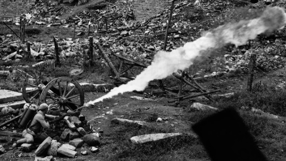"Chinese soldiers were trained by U.S. officers to use incendiary devices called ""flamethrowers"" seen here during the three-month siege of the ancient walled city of Tengchung, a Japanese stronghold. The American effort is often forgotten in China too.  Following the end of the war, civil war broke out, and with the victory of the Communists all mention of American cooperation was stricken from the record."