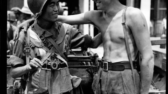 Zhang used the images for an exhibition that tells the often forgotten role of U.S. and Chinese cooperation in World War II.  Here, a British and Chinese soldier exchange greetings when the Chinese and British troops met on the Mandalay Road, Burma on 30 March 1945.
