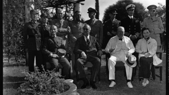 American President Franklin Delano Roosevelt, British Prime Minister Winston Churchill and Chinese leader Chiang Kai-shek meet with other military leaders at the Cairo Conference. The conference addressed issues related to Allied policy against Japan during World War II, and made decisions about the future of Asia.