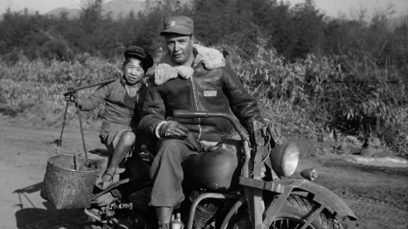 But acknowledging these realities does not mean denying that China's contributions were also very important to the war effort, Mitter adds.  Here, a convoy rider gives a Chinese child a ride in the Tengchun Cutoff, China.