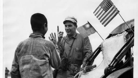 Marine Corporal Richard W. Miller bargains with a Chinese man for a lift in his rickshaw on September 30, 1945. This image was among 23,000 discovered by Chinese historian Zhang Dongpan in 2006 in the U.S. National Archives and Records Office.
