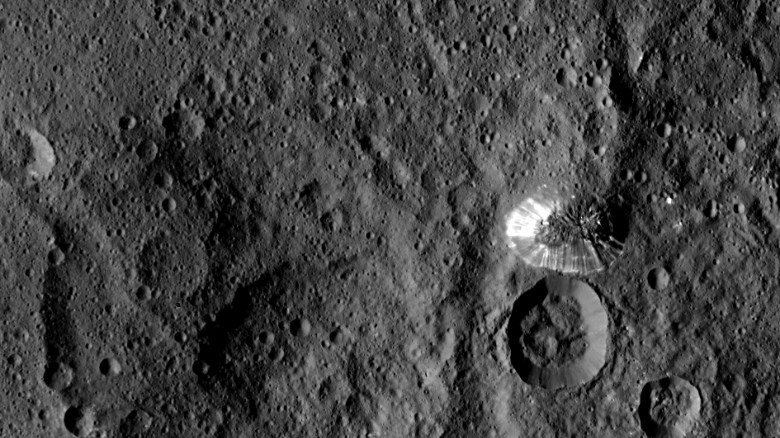 This tall, conical mountain on Ceres was photographed from a distance of 915 miles (1,470 kilometers) by NASA's Dawn spacecraft. The mountain, located in the dwarf planet's southern hemisphere, is 4 miles (6 kilometers) high. The photo was taken on August 19, 2015.