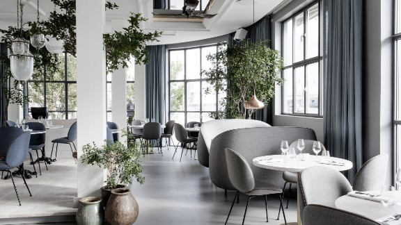 This pan-Indian restaurant is located within Copenhagen's The Standard hotel. Verandah's design is the work of design duo Stine Gam and Enrico Fratesi. The soft minimalism, punctuated with green planted accents sits in an attractive the original 1930′s building.   Design by GamFratesi, Photo by Enok Holsegård and Dinesen/Hviid Photography from Let's Go Out Again, Copyright Gestalten 2015