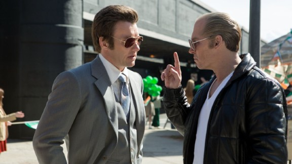 """Black Mass"" stars Johnny Depp, right, as Boston gangster Whitey Bulger. Benedict Cumberbatch plays Bulger"