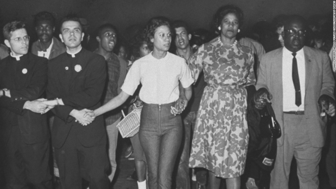 "Civil rights matriarch <a href=""http://www.cnn.com/2015/08/26/us/civil-rights-matriarch-robinson-dies/index.html"">Amelia Boynton Robinson</a>, second from right, died on August 26. She suffered a stroke and had been hospitalized in Montgomery, Alabama. She was in her 100s."