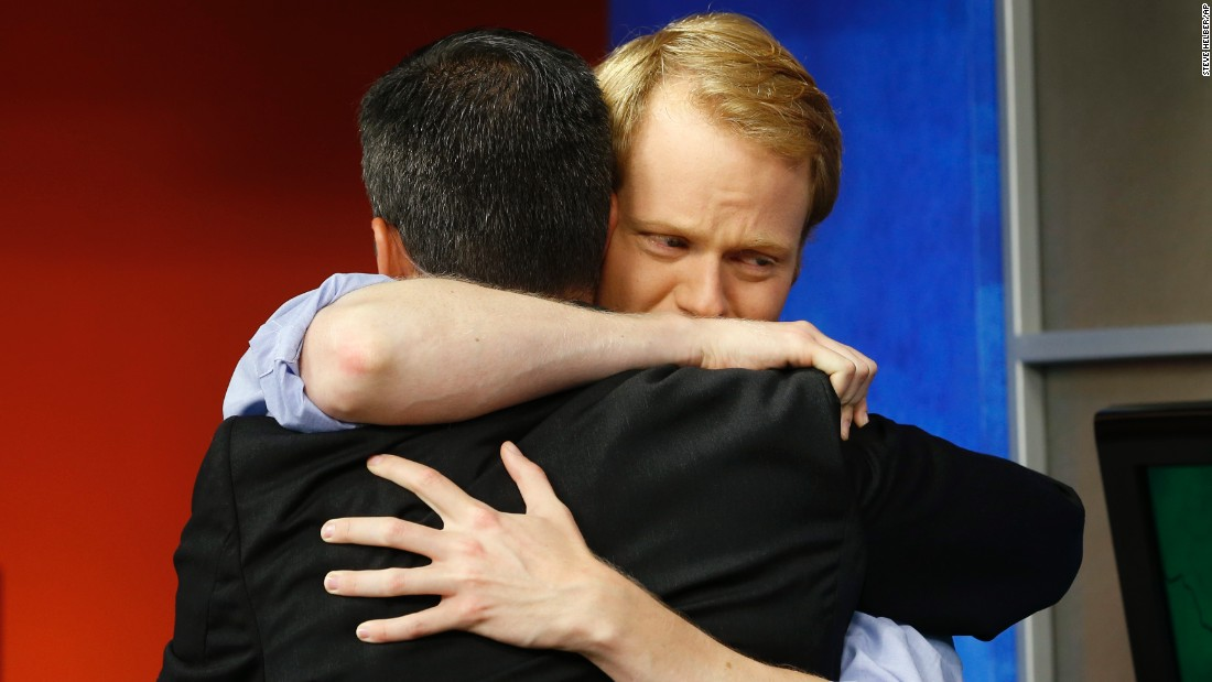 "Television anchor Chris Hurst, right, hugs meteorologist Leo Hirsbrunner during WDBJ's early morning newscast Thursday, August 27, in Roanoke, Virginia. Hurst's girlfriend, WDBJ reporter Alison Parker, <a href=""http://www.cnn.com/2015/08/26/us/virginia-shooting-wdbj/"" target=""_blank"">was fatally shot during a live broadcast</a> the day before. Cameraman Adam Ward was also killed in the shooting, which was carried out by a former co-worker."