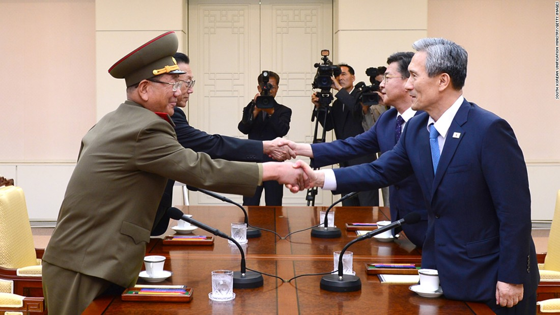 "In this handout image provided by the South Korean Unification Ministry, South Korean National Security Adviser Kim Kwan-jin, front right, shakes hands with Hwang Pyong So, the top political officer of the North Korean military, during high-level talks inside the Demilitarized Zone on Saturday, August 22. Behind them are Hong Yong-pyo, South Korea's unification minister, and Kim Yang Gon, the top North Korean official in charge of inter-Korean affairs. <a href=""http://www.cnn.com/2015/08/22/asia/koreas-tensions/"" target=""_blank"">The meeting</a> came after 48 hours of threats and counter-threats that saw a brief exchange of artillery fire."