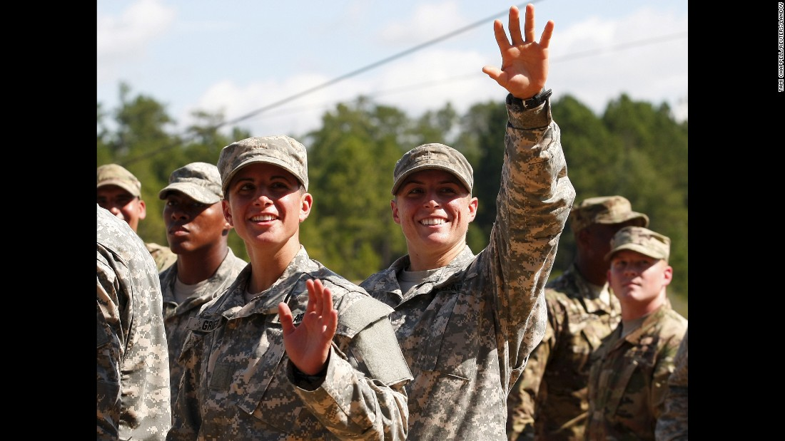 "U.S. Army Capt. Kristen Griest, left, and 1st Lt. Shaye Haver wave to family and friends on Friday, August 21, after they became <a href=""http://www.cnn.com/2015/08/21/us/women-army-ranger-graduation/"" target=""_blank"">the first two women to graduate</a> from the Army's elite Ranger School."