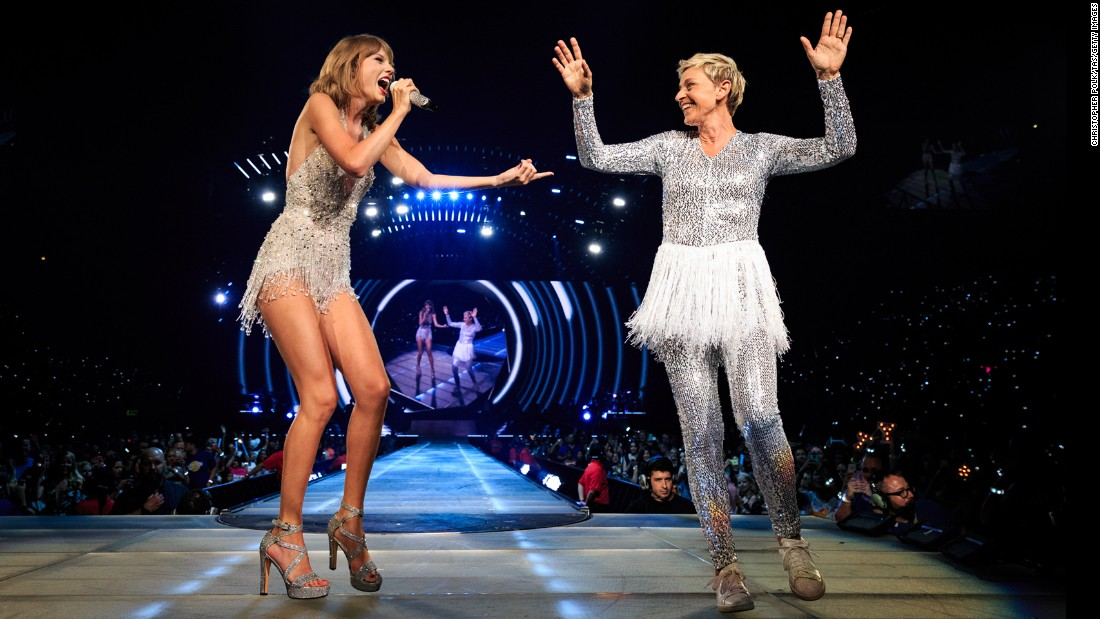 Singer Taylor Swift, left, and talk-show host Ellen DeGeneres perform on stage during Swift's concert in Los Angeles on Monday, August 24.