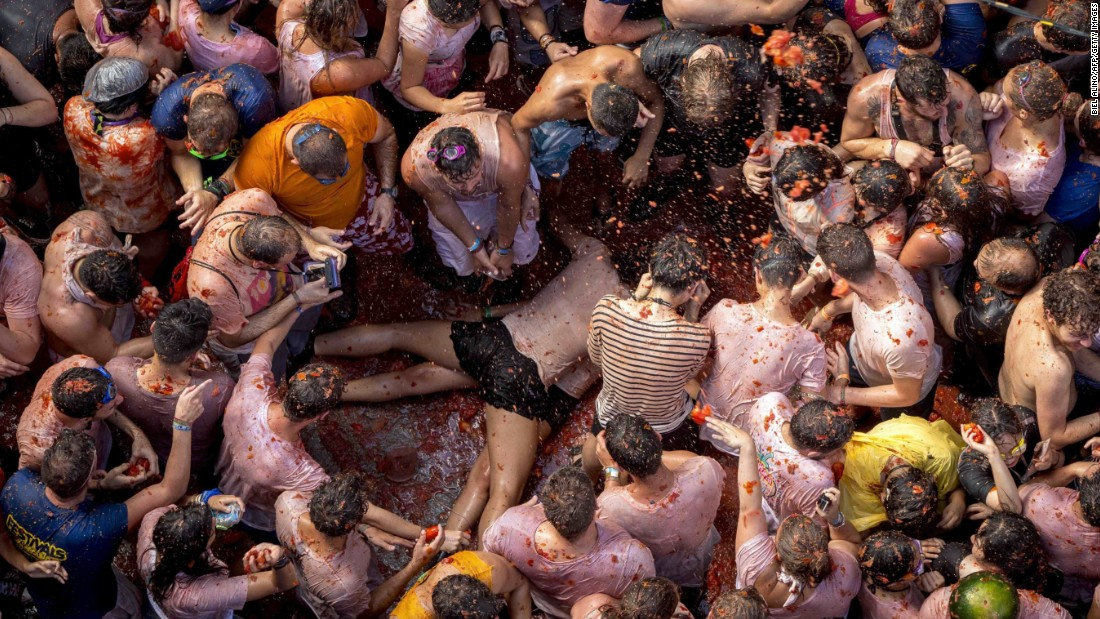 "Revelers throw tomato pulp at one another during the annual <a href=""http://www.cnn.com/2015/08/27/travel/spain-la-tomatina-2015/"" target=""_blank"">La Tomatina festival</a> in Bunol, Spain, on Wednesday, August 26."