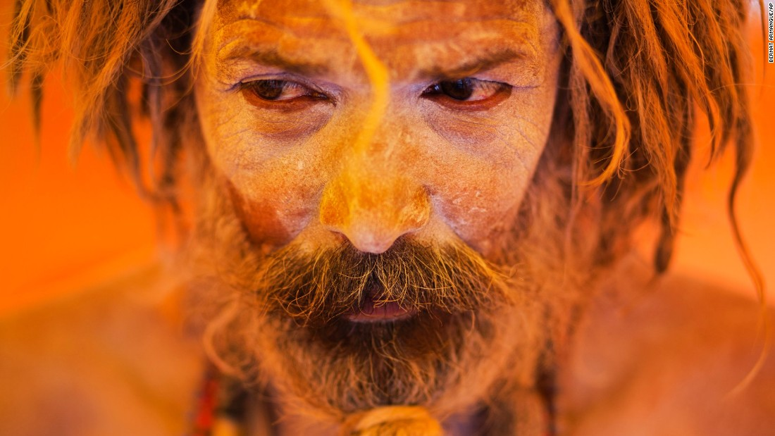 A Hindu holy man pauses inside a tent Thursday, August 27, during the Kumbh Mela, or Pitcher Festival, in Trimbakeshwar, India. Hindus believe taking a dip in the waters of a holy river during the festival will cleanse them of their sins. The festival is held four times every 12 years.
