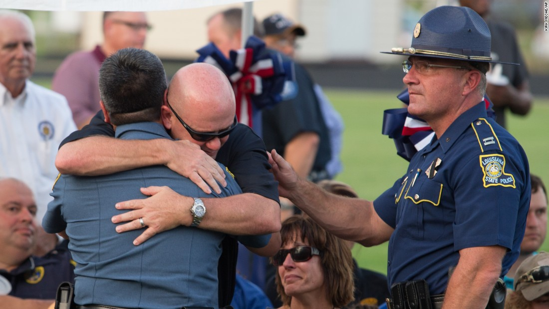 "People hug during a memorial service for Louisiana State Trooper Steven Vincent on Tuesday, August 25. <a href=""http://www.cnn.com/2015/08/24/us/louisiana-trooper-shot/"" target=""_blank"">Vincent was shot</a> during a traffic encounter two days earlier."