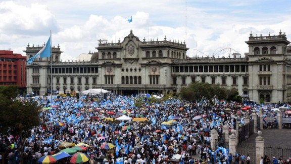 People demonstrate in demand of Guatemalan President Otto Perez to step down over a corruption scandal, in front of the National Palace Guatemala City on August 27, 2015. Perez suffered a double setback Wednesday, after the country