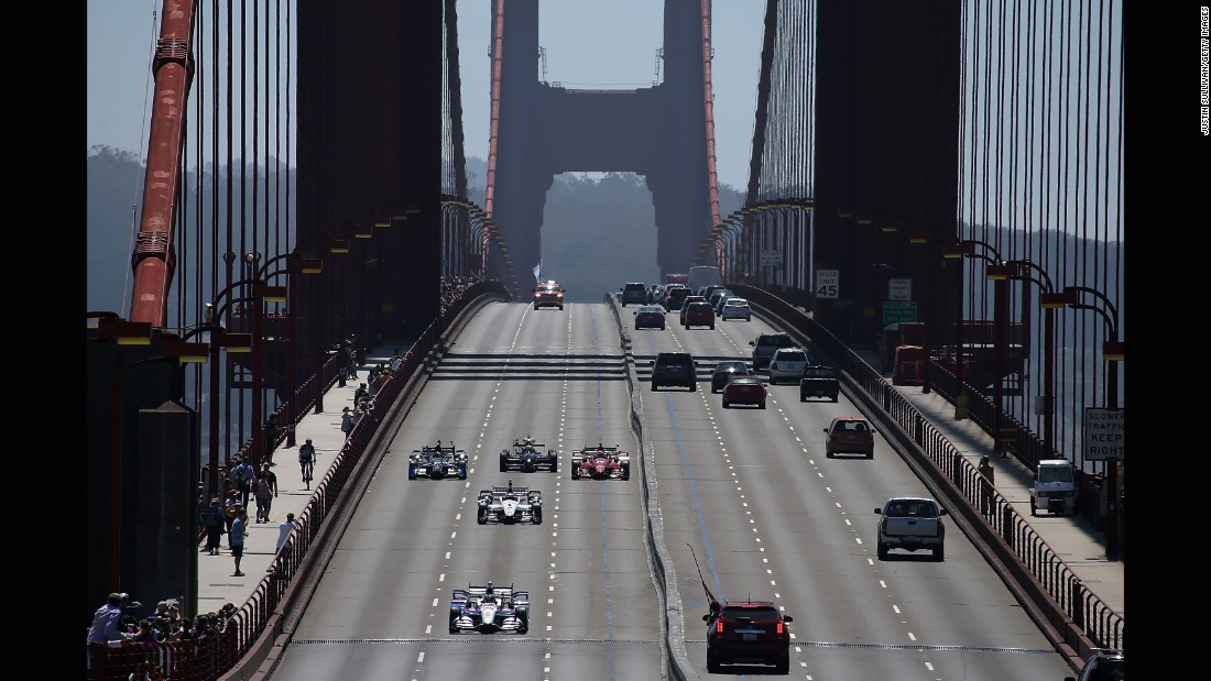 "Marco Andretti leads a pack of race cars over San Francisco's Golden Gate Bridge on Thursday, August 27. The crossing paid tribute to <a href=""http://www.cnn.com/2015/08/24/sport/gallery/indycar-justin-wilson-coma/index.html"" target=""_blank"">IndyCar driver Justin Wilson,</a> who died earlier in the week from injuries he sustained on the racetrack."