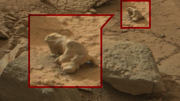 When is a rock more than just a rock? When it's an iguana, of course. Conspiracy theorists have been trawling through photos taken by NASA's Curiosity rover and pointing out mysterious objects that they say are proof of life on Mars.