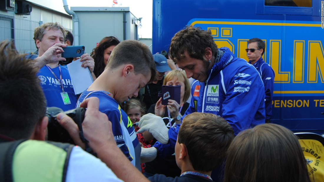 Rossi signs autographs for fans at Silverstone.