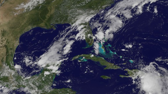 Tropical Storm Erika moves over the Dominican Republic on August 28, 2015. The storm caused devastation on the Caribbean island of Dominica, leaving at least 12 people dead and more than 20 missing. Florida issued a state of emergency as the storm moved toward the South Florida coast.