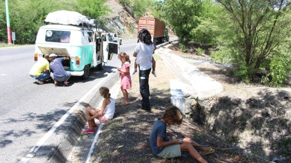 The Walkers wait along a Guatemalan highway after their Volkswagen bus breaks down.