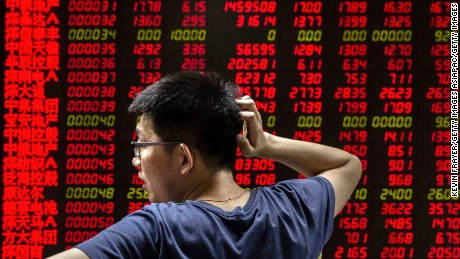 BEIJING, CHINA - AUGUST 27:  A Chinese day trader reacts as he watches a stock ticker at a local brokerage house on August 27, 2015 in Beijing, China. A dramatic sell-off in Chinese stocks caused turmoil in markets around the world, driving indexes lower and erasing trillions of dollars in value. China's government has implemented a series of top-heavy measures to manipulate a market turnaround including its fifth cut to interest rates since November. Concerns about the overall health of China's economy remain amid data showing slower growth.  (Photo by Kevin Frayer/Getty Images)