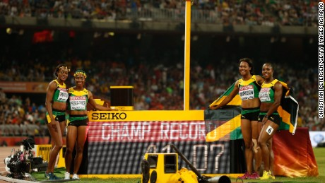 Veronica Campbell-Brown, Natasha Morrison, Elaine Thompson and Shelly-Ann Fraser-Pryce of Jamaica celebrate after winning gold in the Women's 4x100m final at the World Athletics Championships in Beijing.