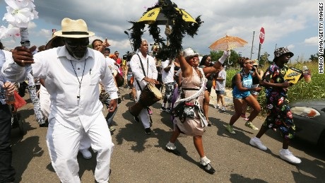 After a solemn morning, New Orleans residents celebrated the city's comeback.