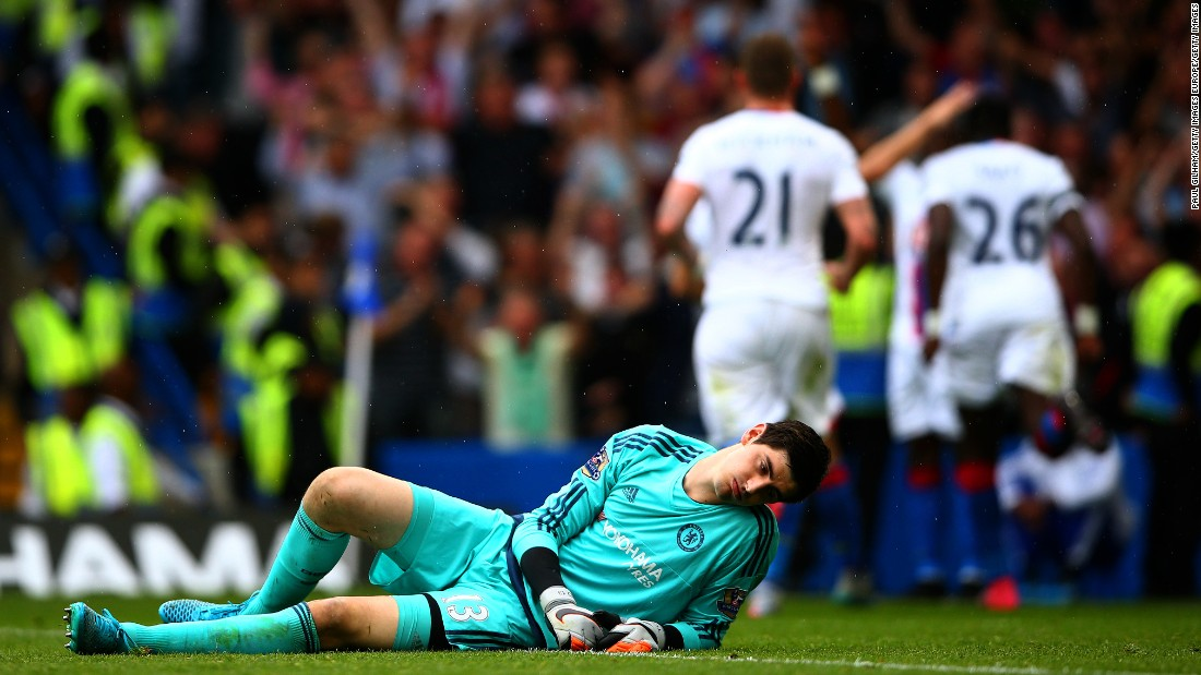 Chelsea keeper Thibaut Courtois looks despondent after being beaten.