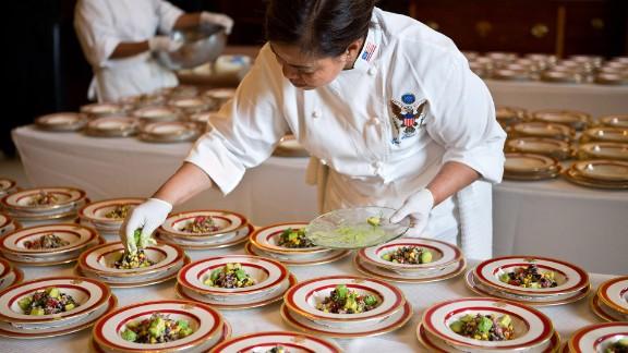 White House Executive Chef Cristeta Comerford prepares dishes of quinoa, black bean and corn salad in 2012.