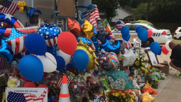 Mourners created a makeshift memorial at the Houston gas station where Harris County Sheriff's Deputy Darren Goforth was gunned down.