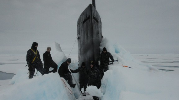 150730-N-ZZ999-008 ARCTIC OCEAN (July 30, 2015) Sailors aboard the fast attack submarine USS Seawolf (SSN 21) remove Arctic ice from the hull after surfacing at the North Pole. Seawolf conducted routine Arctic operations. (U.S. Navy photo/Released)