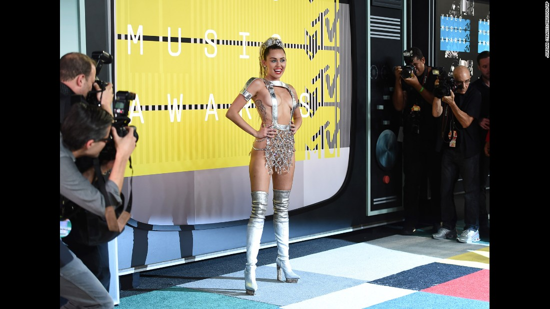 We should have known what kind of night it was going to be Sunday at the 2015 MTV Video Music Awards when host Miley Cyrus arrived in a breast-baring silver Atelier Versace outfit. Here's what else she wore.