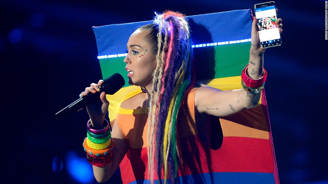 No, that's not a live-action Instagram photo. That's Miley rocking a rainbow-flag outfit that appears to be stretched over a backdrop.