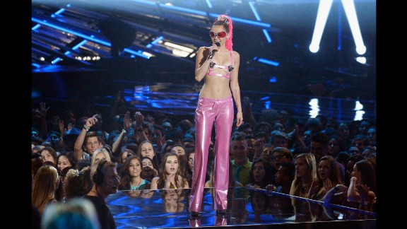 All the MTV VMAs host needed for this ensemble was a pair of pink Versace pants and a barely there bra top. Kooky sunglasses optional.