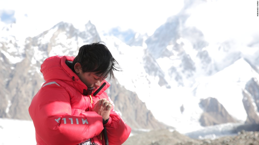 Kuriki clasps his hands, which were badly frostbitten in 2012 and required amputation of several fingers and a thumb, during his Broad Peak ascent on the border of Pakistan and China in 2014.