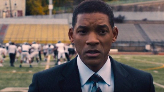 "Will Smith plays Dr. Bennet Omalu in ""Concussion."" Omalu was the first to describe chronic traumatic encephalopathy in American football players, a discovery still having an impact. The film also stars Alec Baldwin and Albert Brooks; Owen Wilson plays NFL Commissioner Roger Goodell. It opens December 25."