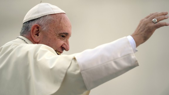 Pope Francis waves to the crowd aboard his Popemobile as he arrives for an audience with participants of an international pilgrimage of altar servers on August 4, 2015 in Saint Peter's Square at the Vatican. AFP PHOTO / FILIPPO MONTEFORTE        (Photo credit should read FILIPPO MONTEFORTE/AFP/Getty Images)