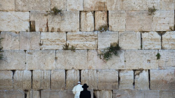 Pope Francis prays next to a rabbi at the Western Wall in Jerusalem