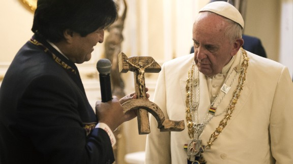 Bolivian President Evo Morales presents the Pope with a gift of a crucifix carved into a wooden hammer and sickle -- the Communist symbol uniting laborers and peasants -- in La Paz, Bolivia, on Wednesday, July 8, 2015.