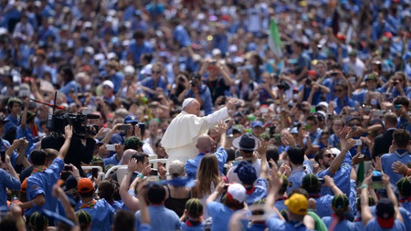 Pope Francis greets a crowd of Italian Catholic boy scouts and girl guides at St. Peter's Square on Saturday, June 13, 2015.