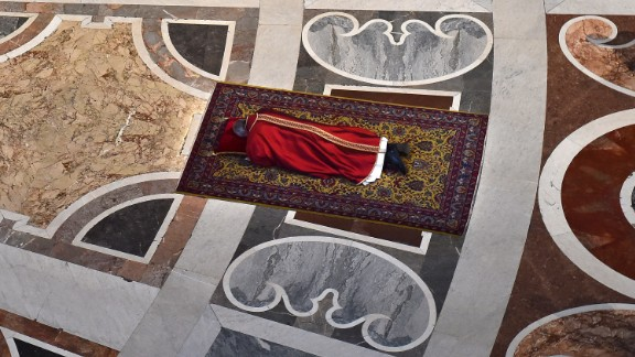 The Pope prays face down on the floor of St. Peter