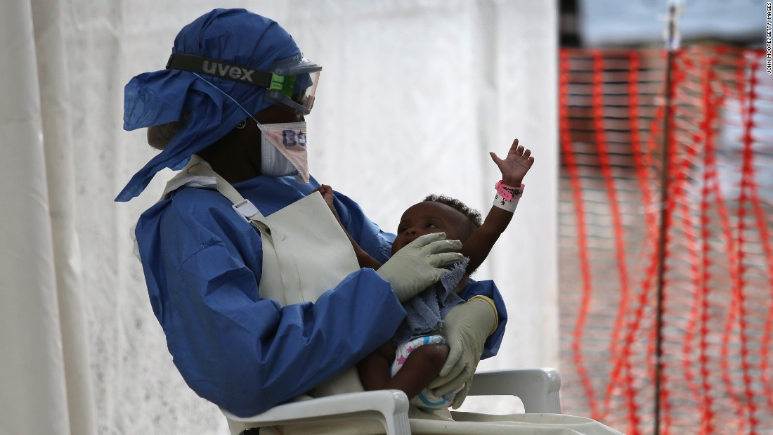 Nurse's aide Benetha Coleman comforts an infant girl thought to have Ebola symptoms in the high-risk area of the Doctors Without Borders' Ebola Treatment Unit in Paynesville, Liberia, in January. The baby's blood test later came back negative.