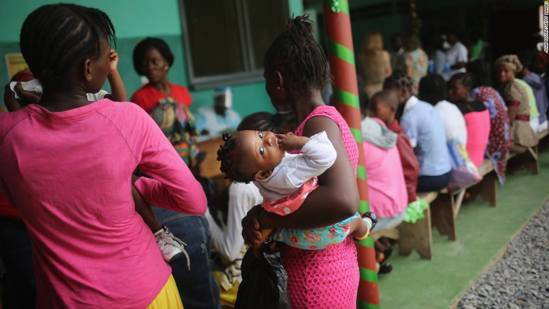 A mother brings her sick child for treatment at Redemption Hospital, formerly an Ebola holding center, in Monrovia in February 2015. Life is slowly returning to normal for many Liberians.