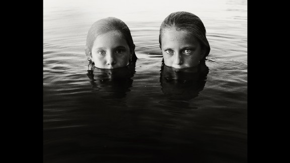Schwedhelm uses an underwater housing for her camera and uses natural light. She chose to shoot in black and white to enhance the contrast between light and dark.