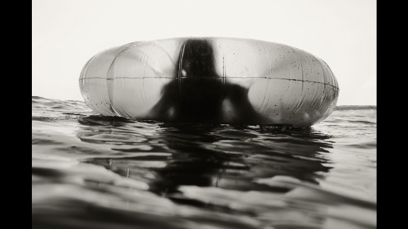 One of Schwedhelm's children floats in an inner tube.