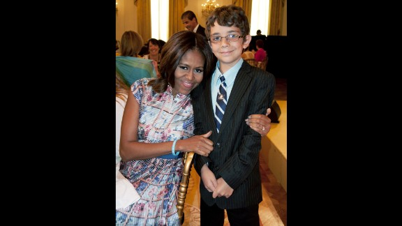 """Braeden Mannering and Michelle Obama at the 2014 """"Kids' State Dinner."""""""