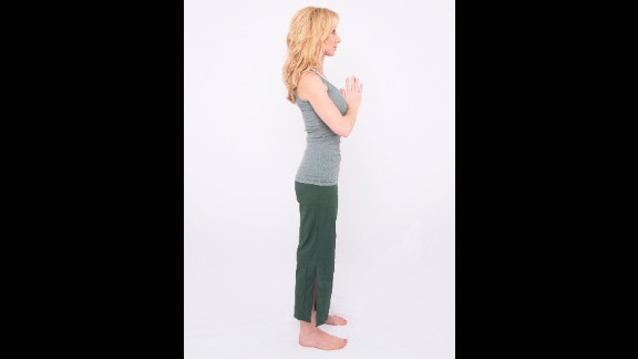 When you first get out of bed, stand with feet hip distance and palms together at the center of your chest.