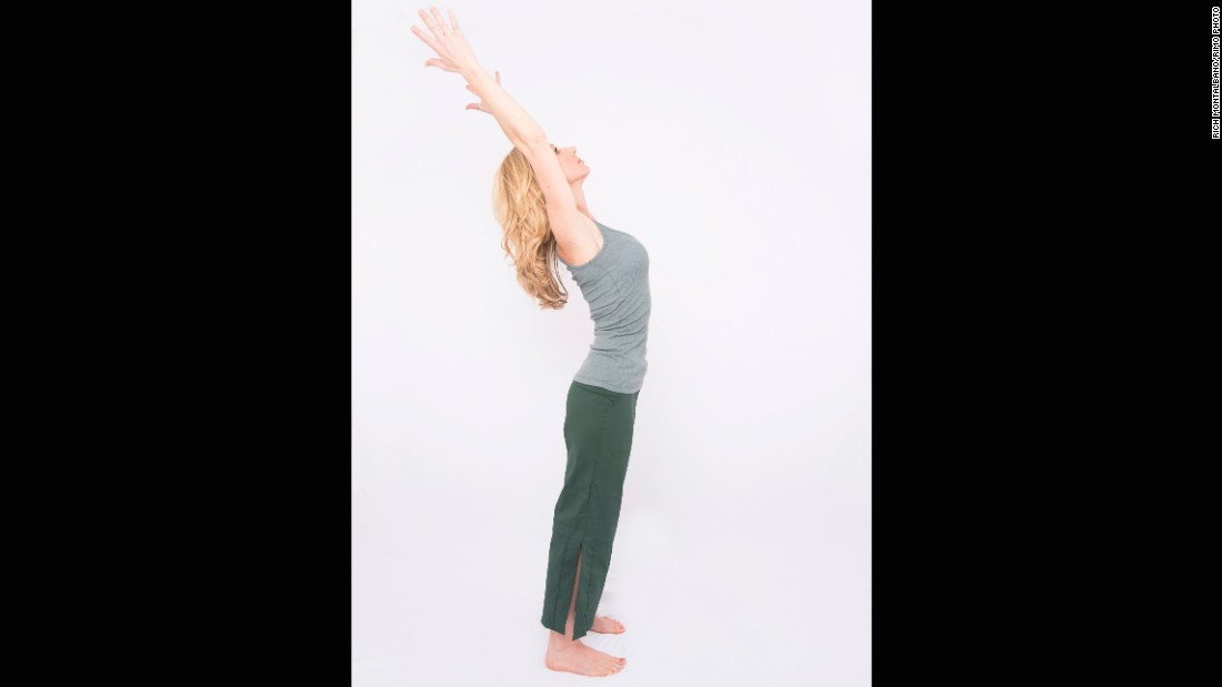 Reaching your arms upward, like in mountain with arms up, stabilize through your core as you lift your chest and extend from your mid back, directing your arms and head gently backwards. Initiate the backbend from the middle of your back to avoid hinging or compressing your low back.
