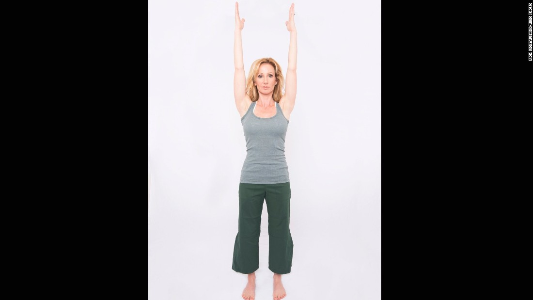 Inhale to raise your arms up, aligning your hands above your shoulders, if possible.
